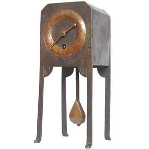 Art Nouveau iron and copper clock by Ludwig Hohlwein