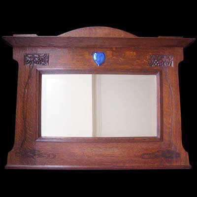 Arts & Crafts carved oak mirror with Ruskin ceramic