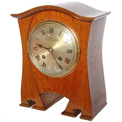 Arts & Crafts golden oak clock