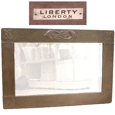 Liberty & Co copper Arts & Crafts mirror by Archibald Knox