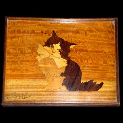 Marquetry panel of a kitten by Emile Galle