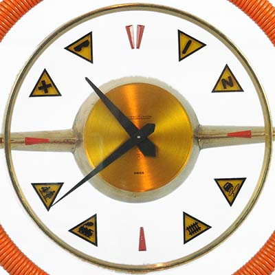 Modernist brass and glass clock with motoring motifs by Jaeger le Coultre (gm815)