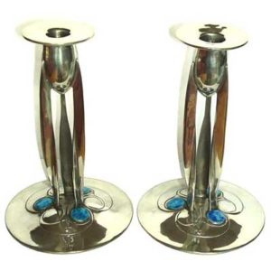 Pair of Tudric pewter and enamel candlesticks by Archibald Knox for Liberty & Co
